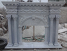 White limestone/marble fireplace