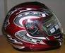 Helmet, chain adjuster, shock absorber